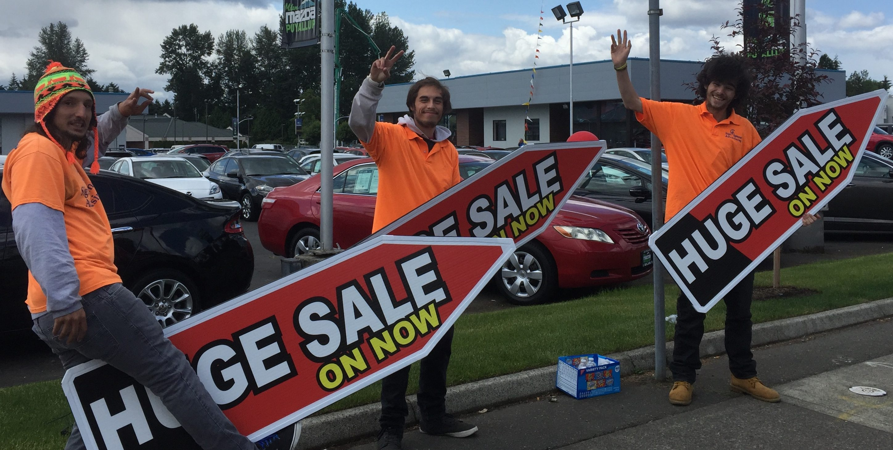 Sign Spinners in Seattle Promote Puyallup Car Sale for Memorial Day